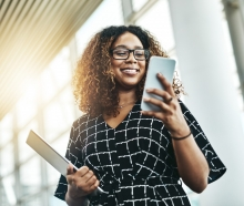 Photo of woman smiling looking at phone